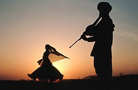 Folk dancer belonging to a gipsy community at Jaisalmer, Rajasthan, India. She is accompanied by a relative musician playing ravanhatta, a local clari...