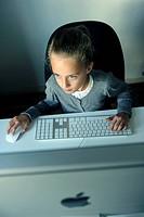 Girl, 9 years, with an iMac computer