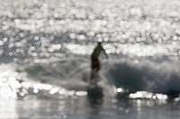 Silhouette Of Surfer On Water