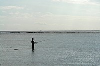 Local fisherman on the Beach near Pointe aux Piments fishing, Mauritius, Africa, Indian Ocean