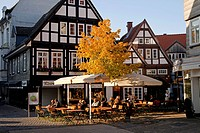 Sidewalk cafe and half-timbered houses in Detmold, North Rhine-Westphalia, Germany, Europe