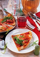 Pizza with rocket salad, Italy, recipe available for a fee