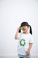 A girl wearing recycling shirt with green leaf
