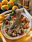 Fish on a bed of vegetables, Greece, recipe available for a fee
