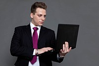 Young man in business suit and tie with notebook