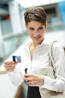 Young businesswoman holding a credit card