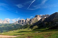 summer view of Italian Dolomites in Fassa Valley with Saas Pordoi and Sassolungo mountain