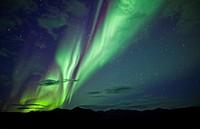 Aurora borealis over mountains along the Dempster highway, Yukon.