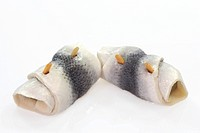 Rolled herring on bright background. Shot in studio.