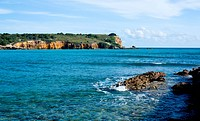 Rocky island in surf off the south west coast of Puerto Rico by Los Morillos Lighthouse