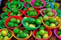 many of fresh limes in basket in fresh market , Asia , Thailand