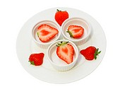 cut juicy strawberry on the plate isolated