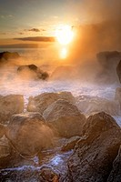 Sunset with Geothermal steam and rocky coast  Reykjanes Peninsula, Iceland