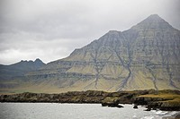 Colorful, Striated Mountain by Coast, Iceland