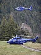 A EC 135 T2i helicopter, at the top, and a AS 332 L1 Super Puma, at the bottom, of the German federal police, Mangfall Mountains, Upper Bavaria, Germa...