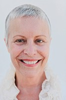 Smiling woman with short gray hair