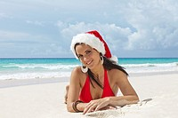 Caribbean  Barbados  Woman on a beach with Santa hat.