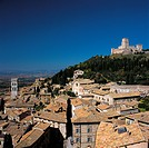 View of Assisi with Torre del Popolo and Rocca Maggiore. Italy, Umbria, Perugia, Assisi. View of Assisi Torre del Popolo houses roofs castle Rocca Mag...
