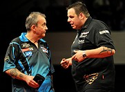 19 04 2012 Bournemouth, England Phil Taylor and Adrian Lewis following their match on Week eleven of the McCoy´s 2012 PDC Premier League Darts from th...