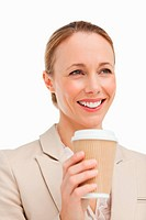 Woman in a suit holding a takeaway coffee against white background