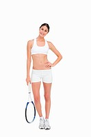 Slim brunette posing with a tennis racket against white background