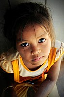 Asian girl looking up sadly, Cambodia, Southeast Asia, Asia
