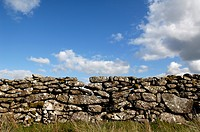 Dry stone wall built of natural stones, against a blue sky with clouds, Dartmoor National Park, Devon, England, United Kingdom, Europe