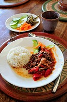 Typical Cuban dish, boiled beef with peppers and rice, in a restaurant in Sancti Spiritus, Cuba, Caribbean