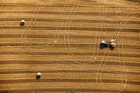 Aerial view, harvesting, straw bales and a tractor, Hamm, Ruhr area, North Rhine_Westphalia, Germany, Europe