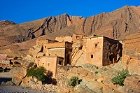 Mountain landscape in the valley of Ait Mansour with a few simple, mud-walled residential houses, Anti-Atlas mountain range, southern Morocco, Morocco...