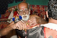 The make_up of the Kathakali character Nakrathundi is being applied, Varkala, Kerala, India, Asia