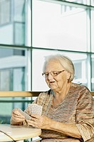 Old woman playing cards