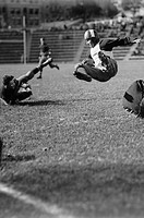 Football Player goes airborne on the field of play