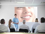 Dentist teaching students in class