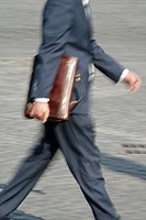 one male commuter carrying briefcase in town