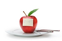 Apple with a paper note