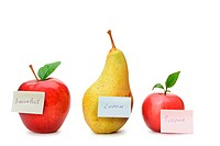 Pear and red apples with paper notes