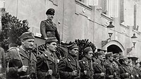The Croatian government chief Ante Pavelic speaks to the troops on apodium, during a military parade. Zagabria, February 1942.