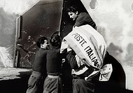 Soldiers of the Italian Royal Air Force Regia AereonauticaItaliana with a load of mail which has been sent to a CSIR camp inthe Donetz Basin. Soviet U...