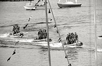 Scuba divers of the Italian Navy sailing on rubber dinghies at FieraCampionaria in Milan. Milan, 1965