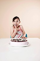 Girl nibbling from a cake