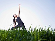 Woman exercising in field