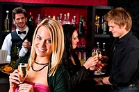 Attractive girl at bar smiling with friends