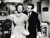 Actors Ruth Roman and Glenn Ford in ´Young Man with Ideas´.Glenn Ford, as Maxwell Webster, grabs by the arm Ruth Roman, asJulie Webster, there is a lo...
