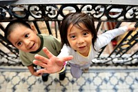 Two indigenous girls, one reaches up, living with their community in a dilapidated house from the colonial period in the centre of Mexico City, Ciudad...