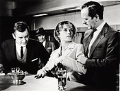 The British actor David Niven acting alongside American actorsShirley MacLaine and Gig Young in the movie ´Ask anygirl´. 1950s