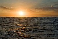 Landscape: the Sun rising over an open sea