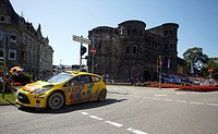 Ford of Henning Solberg from Norway and co_driver Ilka Minor from Austria, in front of the Porta Nigra on the final stages of the ADAC_Rallye Deutschl...