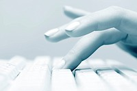 Female hand typing on computer keyboard