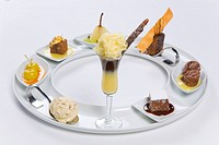 assorted desserts on circular tray